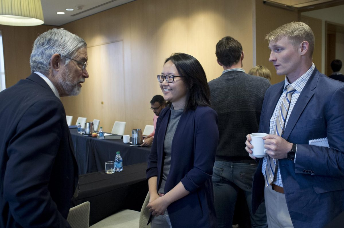 Fellows Dr Jielai Zhang and Dr Hal Holmes in conversation with Prof John Holdren