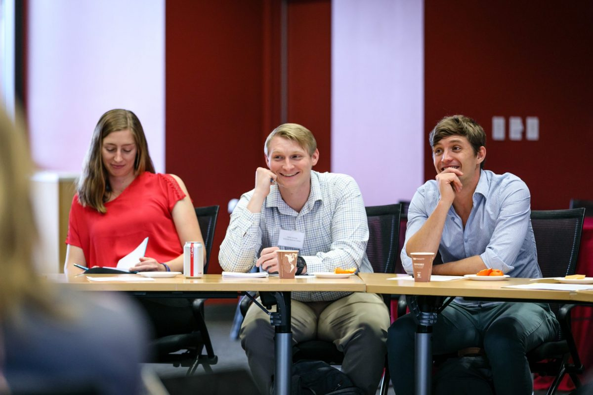 Fellows Peyton Greenside, Hal Holmes, and Fred Richards during a program session at Stanford University.