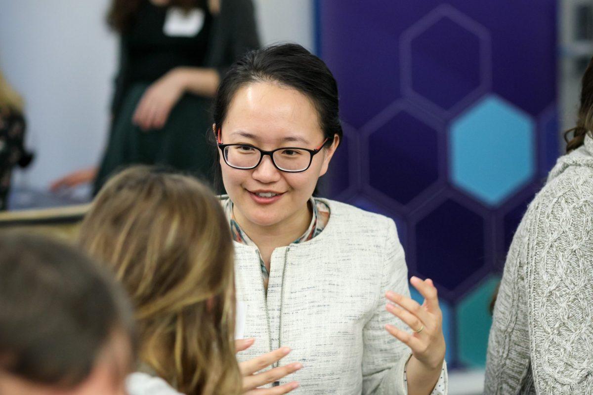 Fellow Jielai Zhang networking with regional postdocs at the Chan Zuckerberg BioHub in San Francisco.