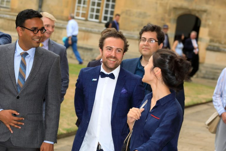 The Global Meeting closed with a formal dinner at Wadham College, Oxford, hosted by the new Warden and CEO of the Rhodes Trust, Dr Elizabeth Kiss. Here, 2018 Fellows, Dr Yogesh Goyal, Dr Mattia Serra and Dr Jina Ko head to the dining room around the college quad.